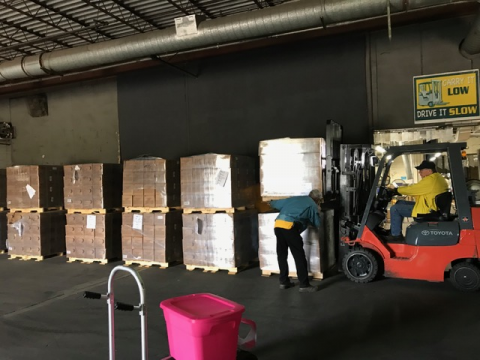 The goods are gathered based on requests and palletized for transport to sites in need.